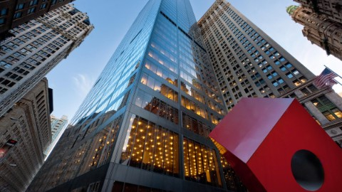 Image 1: Isamu Noguchi's Red Cube in front of the 140 Broadway building.